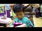 First hair cut - CUTE! - little baby forced by parents for hair cut