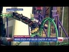 Six flags roller coaster stopped on track